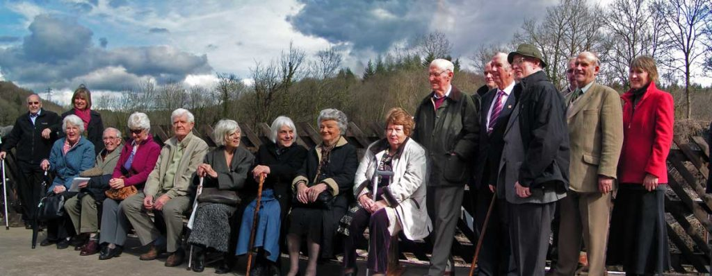 A photo of A group of family members and friends of F W Harvey at the Memorial Bench at Norchard Steam Centre in March 2010.