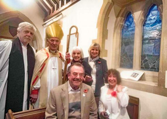 A photo of some of the people present at the dedication of the new window.