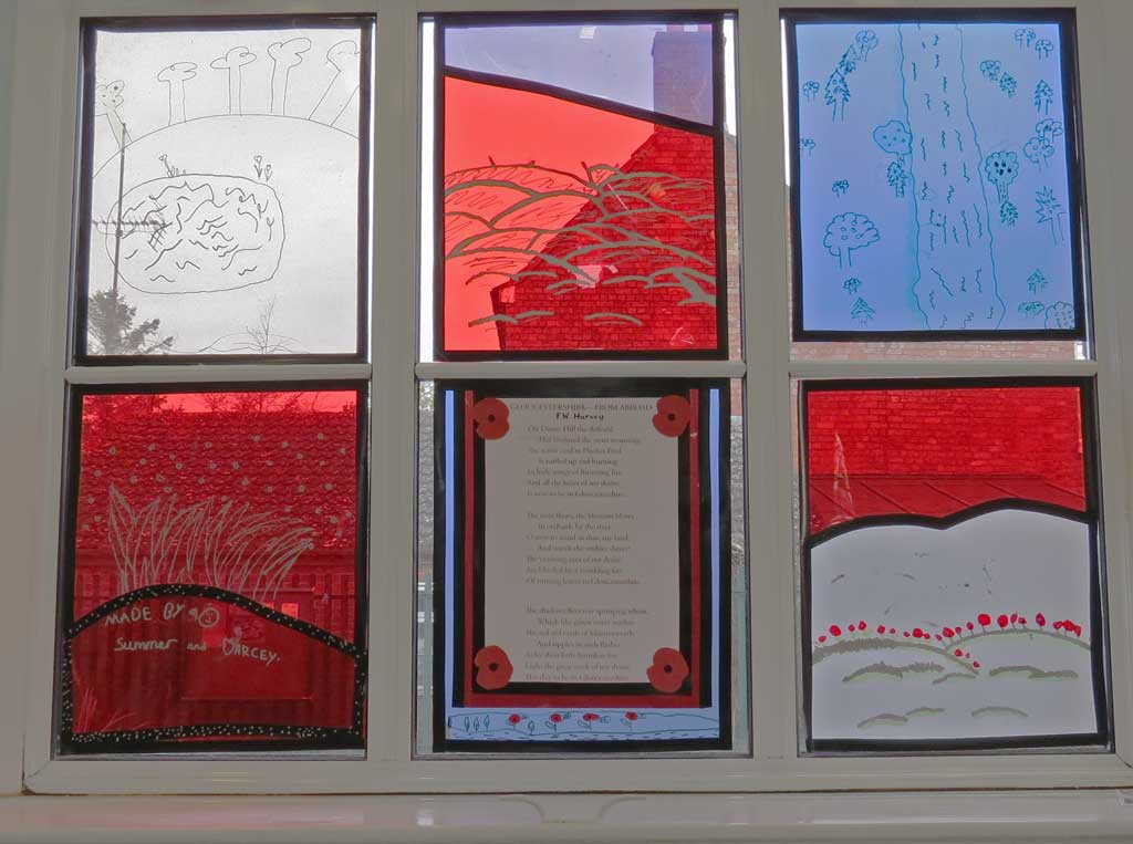 A photo of the the stained glass window the children made using Harvey's poem, Gloucestershire from Abroad for inspiration.