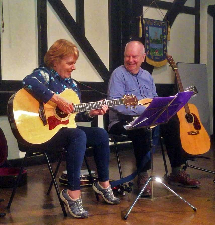 A photo of Jan and Doug performing the Song of Minsterworth